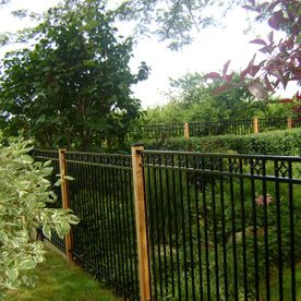 commercial ornamental fence with garden