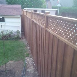 wood fencing with small house