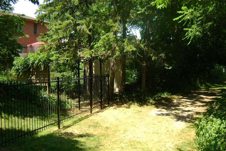commercial ornamental fence with trees