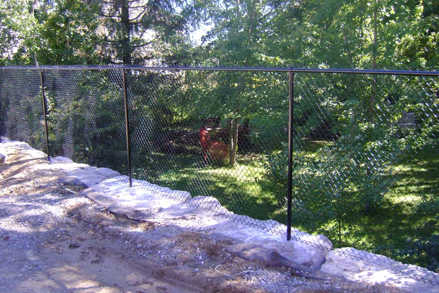 residential chain link fence with garden