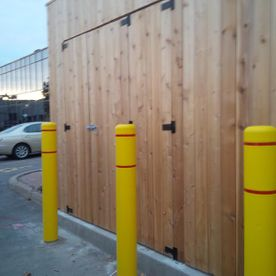 Commercial Wood Fence with yellow ploes1