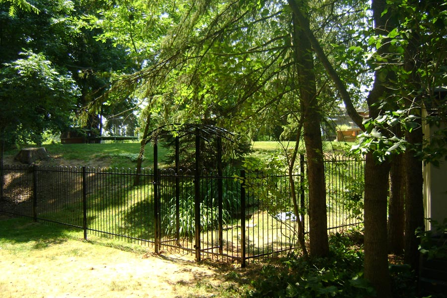commercial ornamental fence with garden house