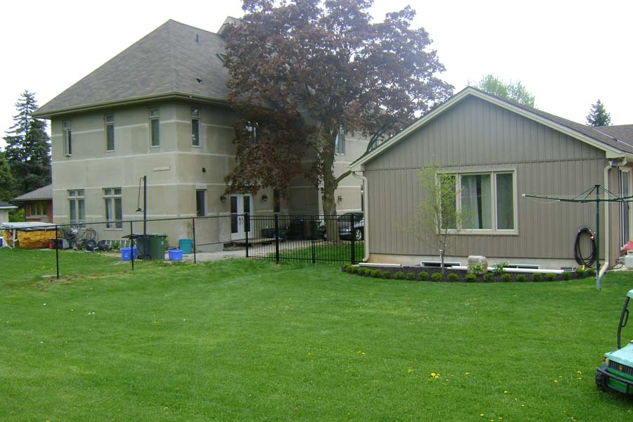 residential chain link fence with house