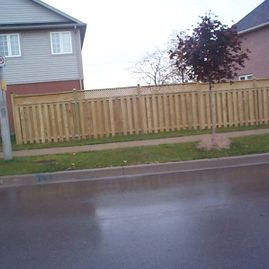 residential wood fencing infront of house