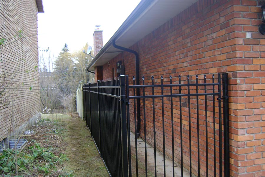 commercial ornamental fence with close house