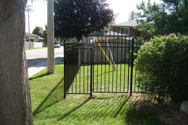 residential iron fence with garden