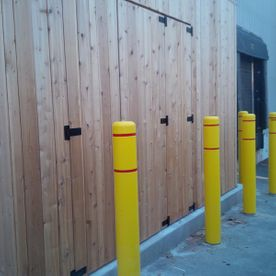 Commercial Wood Fence with yellow ploes