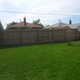 wood fencing with garden
