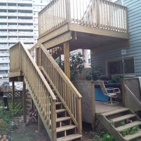 wood fence steps with house
